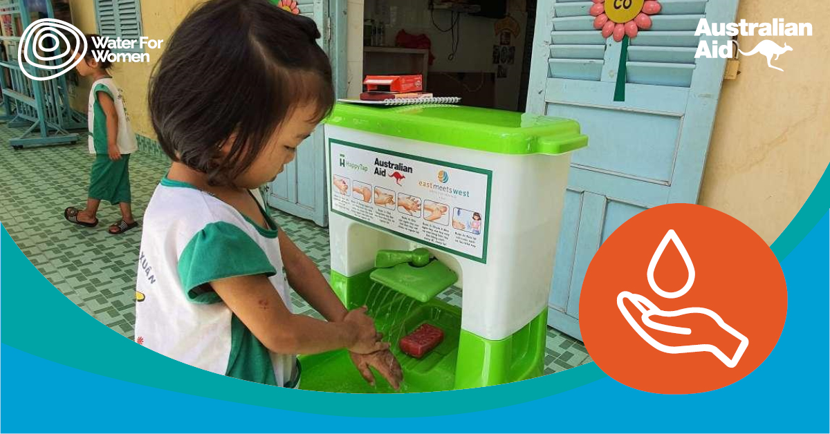 Young Vietnamese girl washes her hands at a handwashing station